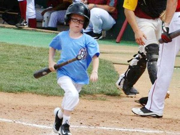 Hit in head by swing at baseball game, bat boy dies