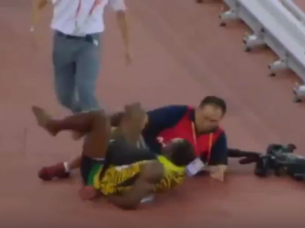 Watch After Historic Gold Cameraman Knocks Down Usain Bolt