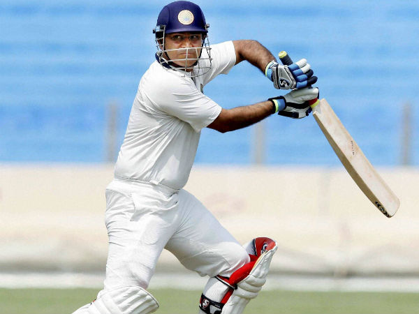 Sehwag blasted his way to a sparkling half-century against Karnataka