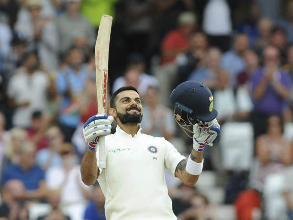 Virat Kohli sends a flying kiss after he hits century.