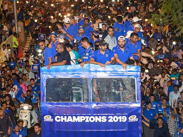 Mumbai indians players greeted by their fans during an open top bus ride