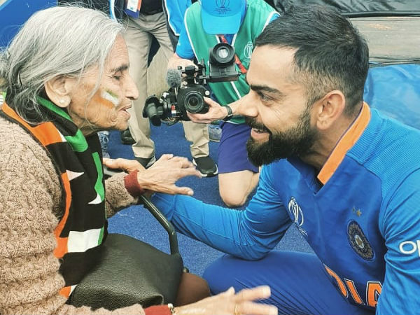 Ind Vs Ban Cricket World Cup 2019 Kohli Rohit Sharma Takes Blessings From 87 Year Old Fan