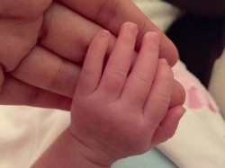 First Look Ms Dhoni S Little Daughter Ziva