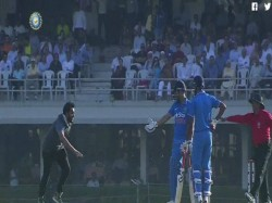 Fan Invades Pitch Touch Ms Dhoni S Feet
