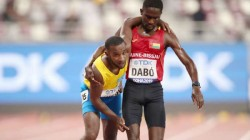 World Athletics Championships Dabo Helps Busby To Reach Finish Line Video