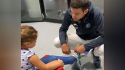 Novak Djokovic Roger Federer Meet Young Girl With Cast On Her Leg